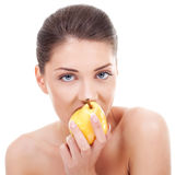 Lovely woman eating pear royalty free stock images