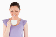 Lovely woman enjoying a cup of coffee Royalty Free Stock Image