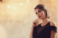 Lovely woman. In evening dress royalty free stock photography
