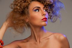 Lovely woman with fasionable hair. Picture of lovely woman with fashionable hair over grey Royalty Free Stock Photo