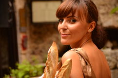 Lovely woman with french bread stock images