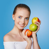 Lovely woman with fruit Stock Photography