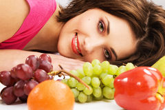 Lovely woman among fruits royalty free stock images