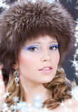 Lovely woman in furry hat over grey Stock Photo