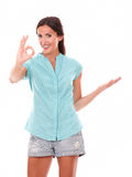 Lovely woman gesturing a great job Stock Photos