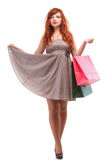 Lovely woman ginger with shopping bags Royalty Free Stock Images