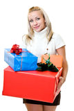 Lovely woman giving gifts at christmas time Stock Photography