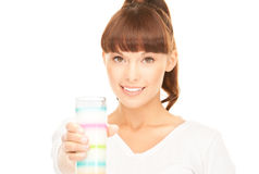 Lovely woman with glass of milk Royalty Free Stock Photos
