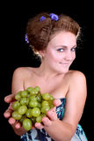 Lovely woman with grape Stock Images