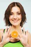 Lovely woman with a half of fresh orange Stock Images