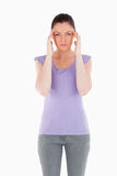 Lovely woman having a headache while standing Stock Photos