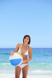 Lovely woman with her ball on the beach Royalty Free Stock Photos