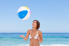 Lovely woman with her ball on the beach Royalty Free Stock Photo