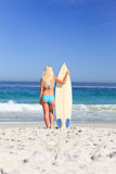 Lovely woman with her surfboard Royalty Free Stock Photo