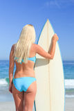 Lovely woman with her surfboard Stock Images