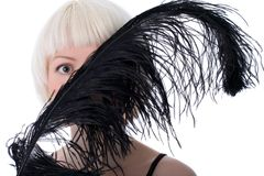 Lovely woman hiding face of black feather Stock Photography