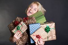 A lovely woman holding a many gift boxes Royalty Free Stock Image