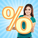 Lovely woman holding percent sign Stock Image
