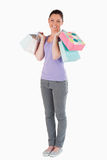 Lovely woman holding shopping bags while standing Stock Image