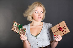 A lovely woman holding two gift boxes Stock Photos
