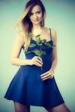 Lovely woman holding white rose Stock Photo