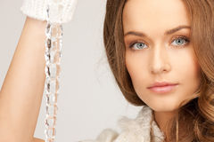 Lovely woman with icicle Royalty Free Stock Photography