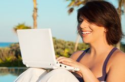 Lovely woman with laptop computer Stock Images
