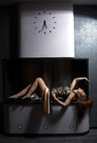 Lovely woman laying in fireplace. Royalty Free Stock Photo