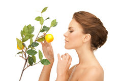 Lovely woman with lemon twig Stock Photography