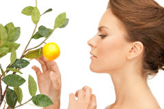 Lovely woman with lemon twig Stock Photos