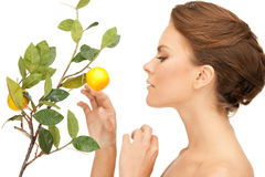 Lovely woman with lemon twig Royalty Free Stock Image