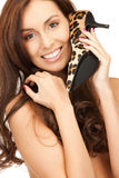 Lovely woman with leopard shoes Royalty Free Stock Images