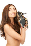 Lovely woman with leopard shoes Stock Images