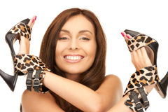 Lovely woman with leopard shoes Stock Photography