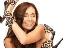 Lovely woman with leopard shoes Royalty Free Stock Photography