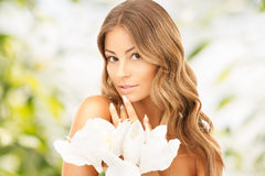 Lovely woman with lily flower Stock Photo