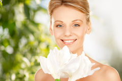 Lovely woman with lily flower Stock Photos