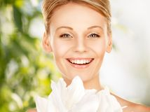 Lovely woman with lily flower Royalty Free Stock Image