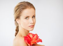 Lovely woman with lily flower Stock Image