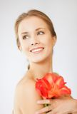 Lovely woman with lily flower Royalty Free Stock Photos