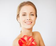 Lovely woman with lily flower Stock Photography