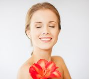 Lovely woman with lily flower Royalty Free Stock Images