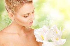 Lovely woman with lily flower and butterflies Royalty Free Stock Photos