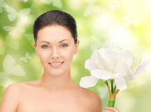 Lovely woman with lily flower and butterflies Stock Photo