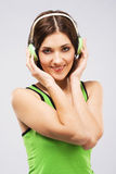 Lovely woman listening a music in headphones Stock Image