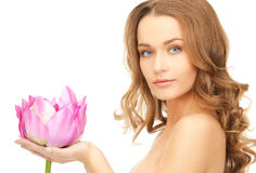 Lovely woman with lotos flower. Picture of lovely woman with lotos flower Stock Image