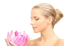 Lovely woman with lotos flower. Bright picture of lovely woman with lotos flower Royalty Free Stock Photography