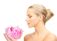 Lovely woman with lotos flower. Bright picture of lovely woman with lotos flower Stock Photo