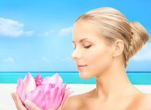 Lovely woman with lotos flower. Bright picture of lovely woman with lotos flower Stock Photos