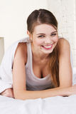 Lovely woman lying in bed Stock Photography